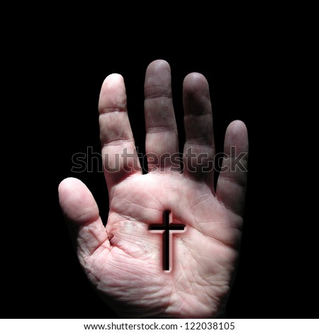 Hand with cross - stock photo