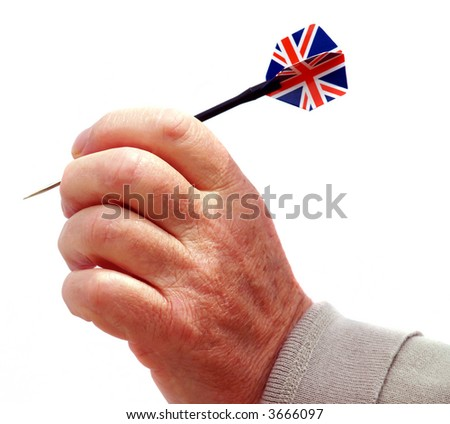 Hand with dart with union jack flag of Britain - stock photo