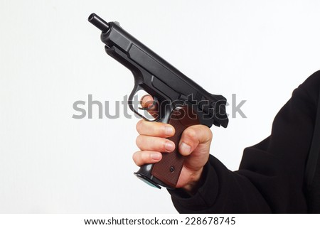 Hand with discharged semi-automatic pistol on a white background - stock photo
