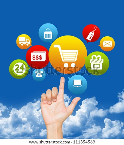 Hand With E-Commerce Icon Above in Blue Sky Background For Internet and Online Shopping Concept - stock photo