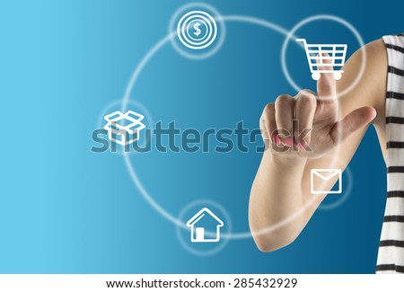 Hand With E-Commerce Icon Around For Internet and Online Shopping Concept  on blue Background - stock photo