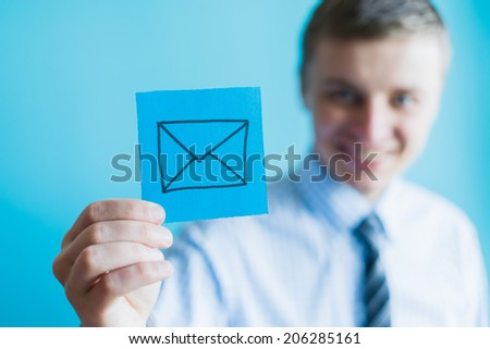 hand with email icon - stock photo