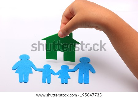 hand with family icon and green house - stock photo