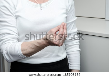 hand with  fingers gesture on white background - stock photo