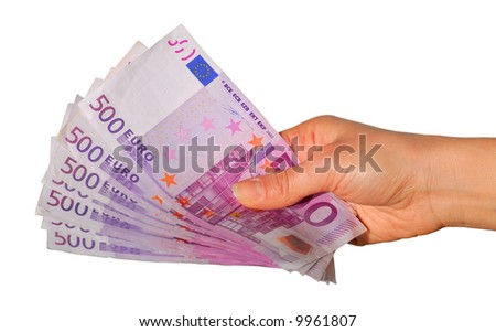 Hand with five hundred euro notes isolated on white background