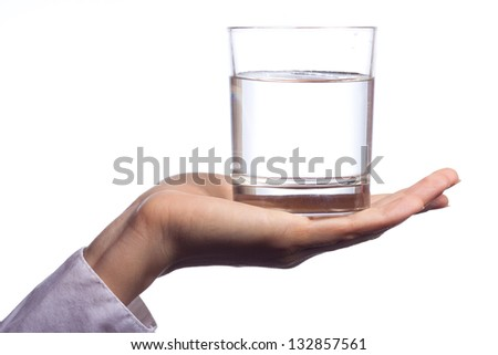 Hand with glass isolated on white