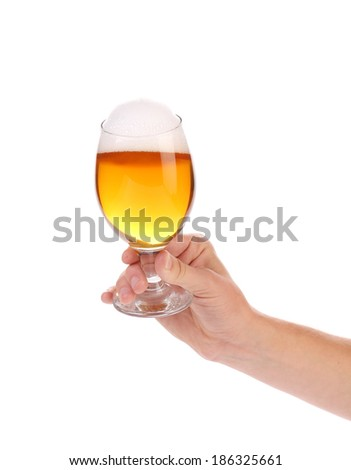 Hand with glass of beer. Isolated on a white background. - stock photo