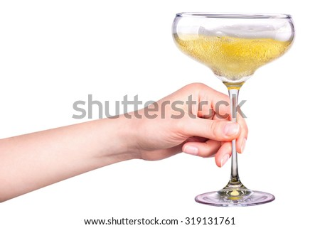 Hand with glass of champagne isolated on a white background