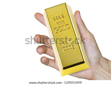 hand with glove holding a gold bar (with clipping path) - stock photo