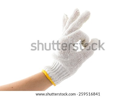 hand with glove is OK, Okay sign on white background - stock photo