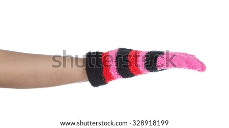 hand with glove is picking on white background