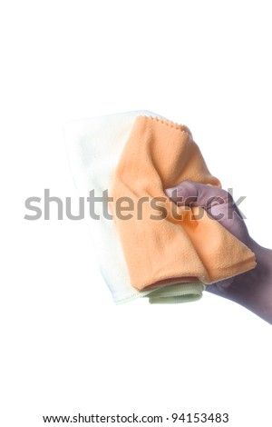 Hand with green glove holding cleaning napkin; isolated on white - stock photo