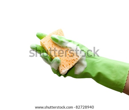Hand with green glove holding foamy cleaning sponge; isolated on white - stock photo