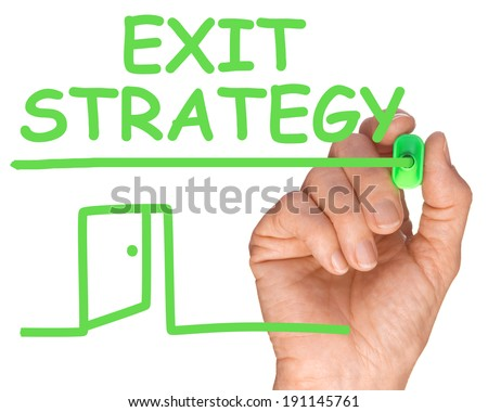 Hand with Green Pen Writing Exit Strategy for the future of business  - stock photo