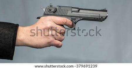 Hand with gun - stock photo