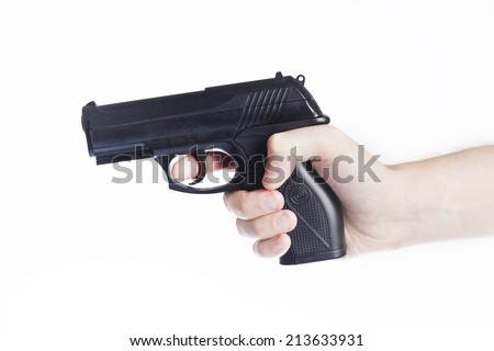 Hand with gun isolated