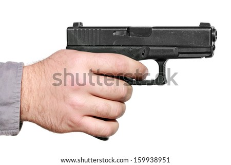 Hand with gun ready to shoot isolated on the white background - stock photo