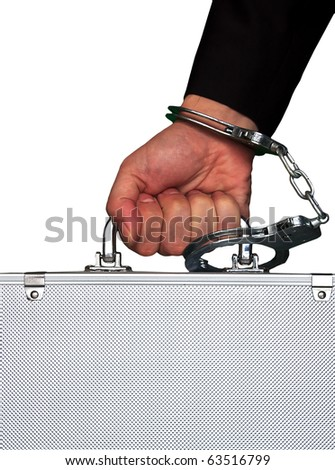 hand with handcuff and a suitcase - stock photo