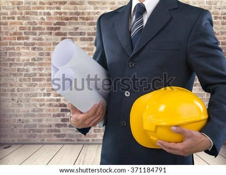 Hand with hardhat.