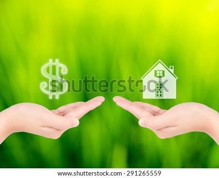 Hand with icon money and house shape. new house buy concept or sell house - stock photo
