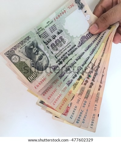 hand with indian notes