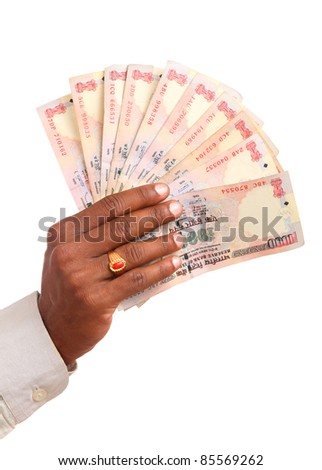 Hand with Indian thousand rupee notes. - stock photo