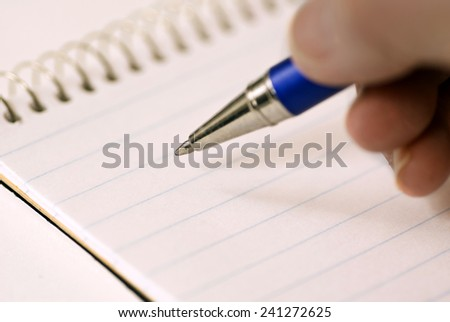 Hand With Ink Pen/ Ready To Start Writing Or Taking Notes - stock photo
