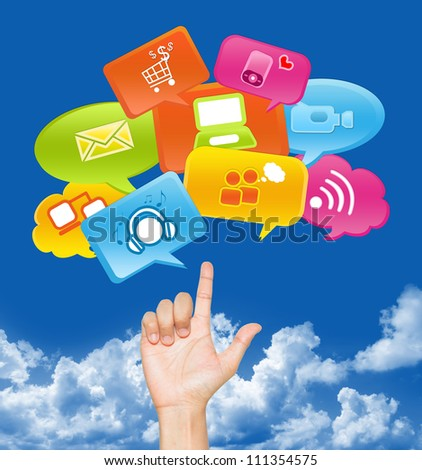 Hand With internet Communication Icon Above in Blue Sky Background For Social Media, Social Marketing or E-Commerce Concept - stock photo