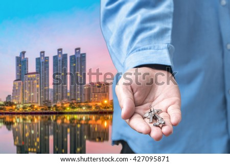 Hand with Key condo - stock photo