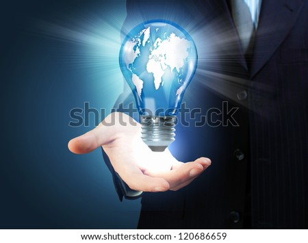 Hand with lamp and hands of a business person - stock photo