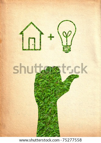 Hand with light bulb and house.(Green energy concept) - stock photo