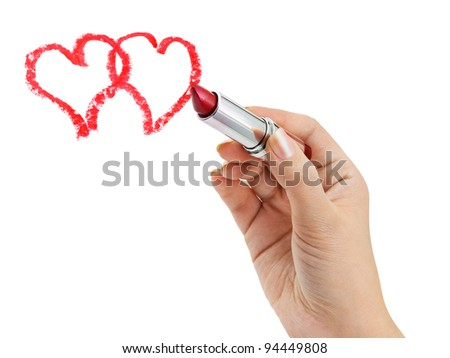 Hand with lipstick drawing hearts isolated on white background - stock photo