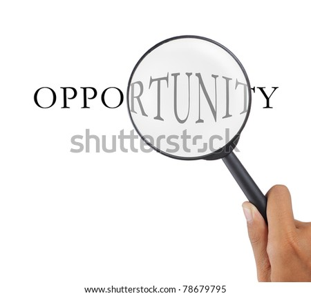 hand with magnifier glass and opportunity text - stock photo