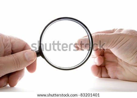 Hand with magnifying glass - stock photo