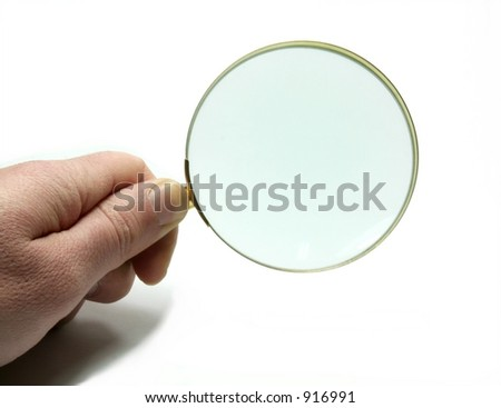 hand with magnifying glass on white