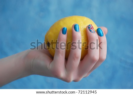 Hand with manicure in British Flag stile - stock photo