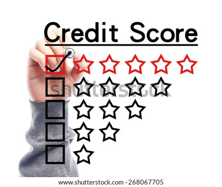 Hand with marker is drawing Credit score concept on the transparent white board. - stock photo