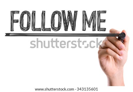 Hand with marker writing: Follow Me - stock photo