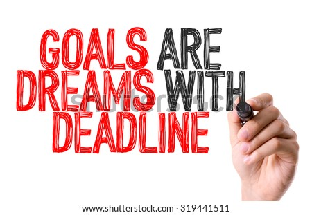 Hand with marker writing: Goals Are Dreams With Deadline - stock photo