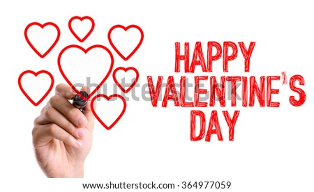 Hand with marker writing: Happy Valentines Day - stock photo