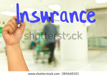 Hand with marker writing : Insurance  - stock photo