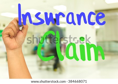 Hand with marker writing : Insurance Claim - stock photo