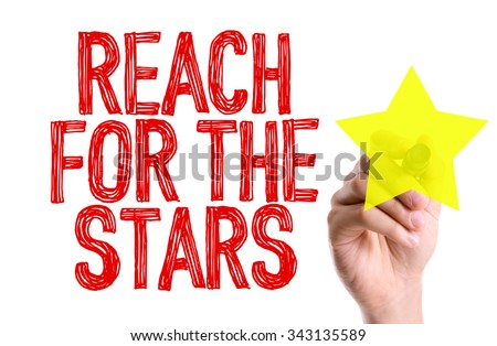 Hand with marker writing: Reach For The Stars - stock photo