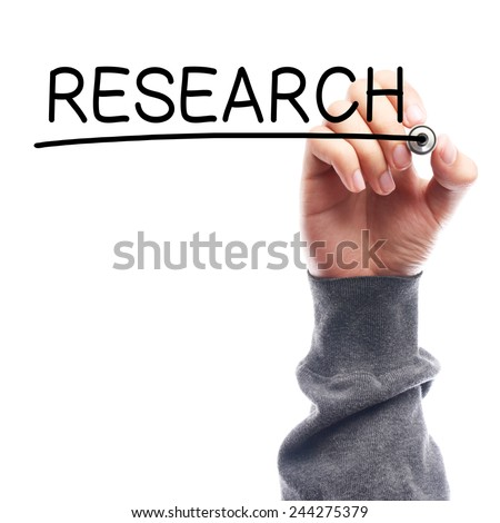 Hand with marker writing Research on transparent board against white background. - stock photo