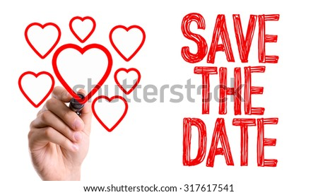 Hand with marker writing: Save The Date - stock photo
