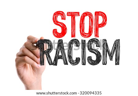 Hand with marker writing: Stop Racism - stock photo
