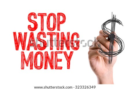 Hand with marker writing: Stop Wasting Money - stock photo