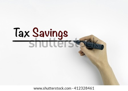 Hand with marker writing: Tax Savings - stock photo