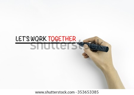 Hand with marker writing the text - Let's work together - stock photo