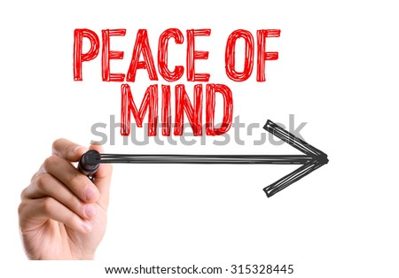 Hand with marker writing the text Peace of Mind - stock photo
